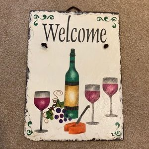 Slate Welcome sign with wine bottles